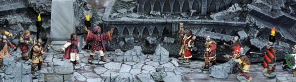 A Summoner, his apprentice and soldiers confront a Chronomancer with her apprentice and party in  the ruins of The Library.