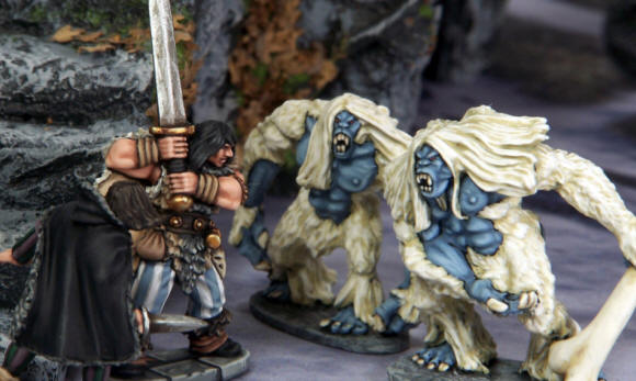 Barbarian and Thief encounter Snow Trolls in the frozen city.