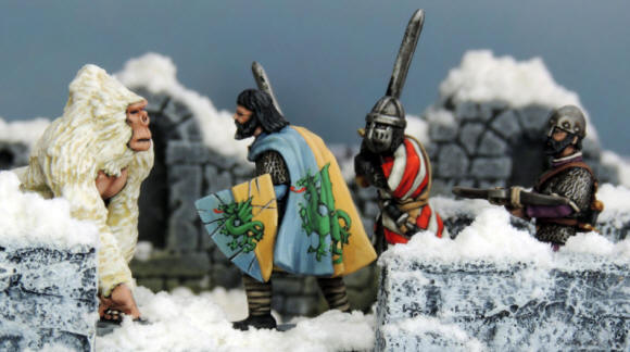 Free Knight, Templar and Marksman take on the massive White Gorilla in the snow of Frostgrave.